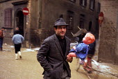 Man with toy doll, Florence Floods, Italy, 1966. The floods in Florence in early November, 1966, were the worst in over five hundred years and resulted in the loss of over 100 Florentine lives as well... - Romano Cagnoni - 14-11-1966