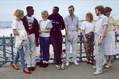Young people chatting by Margate beach 1986. They joined thousands of others at the seaside on Whit Monday bank holiday - Martin Mayer - 1980s,1986,BAME,BAMEs,bank,BANKS,beach,BEACHES,Black,black and white,BME,bmes,COAST,coastal,coasts,day out,Day Trip,diversity,ethnic,ethnicity,fashion,FEMALE,holiday,holiday maker,holiday makers,holid