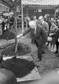 Prime minister Harold Wilson opening new flats and planting a tree, London 1975 - NLA - 1970s,1975,ceremonial,ceremonies,ceremony,Council Housing,Council Services,Council Housing,Council Services,flat,flats,Harold Wilson,housing,Labour Party,local authority,London,male,man,men,minister,M