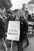 Demonstration in Brixton, Lambeth, in defence of local democracy and against the rate-capping plans and the cuts to services forced on councils by the Thatcher government. - NLA - 1980s,1984,activist,activists,campaign,campaigning,CAMPAIGNS,council,cuts,defence,DEFENSE,democracy,DEMONSTRATING,Demonstration,Lambeth,local,Local Authority,Local democracy,male,man,member,member mem