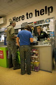 Launceston, Cornwall, father and son at the Co-op Store check out counter - David Mansell - 14-07-2015