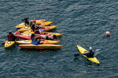 Port Quinn, Cornwall, local pupils learning canoe safety techniques. The instructors are retired school teachers - David Mansell - 15-07-2015