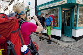 St Ives, Cornwall, walkers stop to take a photograph to remember visiting the town - David Mansell - 17-07-2015