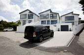 St Ives, Cornwall, newly built white luxury holiday homes - David Mansell - 2010s,2015,4x4,AFFLUENCE,AFFLUENT,AUTO,AUTOMOBILE,AUTOMOBILES,AUTOMOTIVE,black,Bourgeoisie,car,cars,COAST,EBF,Economic,Economy,elite,elitism,Four By Four,high,high income,holiday,HOLIDAYS,home,homes,H
