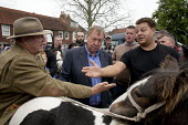 Horsmonden Horse Fair, is held in the hop growing area in the Weald of Kent. Red Lee Smith, (black top) successfully persuades Gilbert Smith, the seller of the horse to reduce his asking price. This C... - David Mansell - 2010s,2015,bargaining,break,buy,buyer,buyers,buying,commodities,commodity,communicating,communication,conversation,conversations,dialogue,discourse,discuss,discusses,discussing,discussion,domesticated