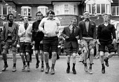 Silver Jubilee of Queen Elizabeth II, men dancing at a street party Ruslip, London 1977 with trousers rolled up to Knees Up Mother Brown - David Mansell - 1970s,1977,2nd,ACE,adult,adults,cities,City,COMMEMORATE,COMMEMORATING,commemoration,COMMEMORATIONS,commemorative,communities,community,Culture,dance,dancer,dancers,dancing,Elizabeth,flag,flags,highway