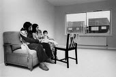 Vietnamese Boat People housed in new council flat, West Drayton, London 1979 - David Mansell - 1970s,1979,accommodation,adult,adults,Asian,Asians,assisting,babies,baby,BAME,BAMEs,Black,BME,bmes,Boat,BOATS,boy,boys,CHILD,CHILDREN,cities,city,council,council housing,council housing,couple,COUPLES
