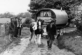 Appleby Horse Fair, Cumbria 1978 dealer showing horse with a traditional horse drawn caravan behind - David Mansell - ,1970s,1978,animal,animals,Appleby Horse Fair,caravan,caravans,communities,community,dealer,DEALERS,dealing,Domesticated Ungulates,equestrian,equine,Fair,gipsey,Gipsey Gipsy Gypsey,Gipsies,Gipsy,gypse