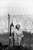 No Cruise missiles protest RAF Molesworth 1985 Cut out of Margaret Thatcher pinned onto the barbed wire perimeter fence of the cruise missile base - David Mansell - peace movement,1980s,1985,activist,activists,against,airforce,american,americans,anti,Anti Nuclear weapons,Anti War,Antiwar,armed forces,barbed wire,campaign,Campaign for nuclear disarmament,campaigni
