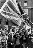 Burning the Union Jack flag, Ant facism protest against NF Lewisham London 1977 - David Mansell - 1970s,1977,activist,activists,against,ALCARAF,Anti Fascist,ARAFCC,BAME,BAMEs,Black,Black and White,BME,bmes,burn,burning,BURNS,campaigner,campaigners,CAMPAIGNING,CAMPAIGNS,cities,City,DEMONSTRATING,De