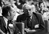 Jack Jones TGWU talking with Alex Kitson TUC conference Brighton 1976 - Chris Davies - 1970s,1976,Alex Kitson,communicating,communication,Conference,conferences,conversation,delegate,delegates,delegation,dialogue,Gen Sec,Jack Jones,member,member members,members,SPEAKER,SPEAKERS,speaking