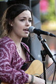 Anya Sweeney singing, Queen Elizabeth II 90th birthday celebration weekend, street party Alcester Warwickshire - John Harris - 2010s,2016,ACE,adolescence,adolescent,adolescents,Arts,CELEBRATE,CELEBRATING,celebration,CELEBRATIONS,Culture,female,females,girl,girls,guitar,guitars,Leisure,LFL,LIFE,Lifestyle,melody,music,MUSICAL,m