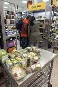 Customers looking at discounted quick sale food items marked down in price, Morrisons - John Harris - 22-11-2017