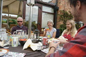Family enjoying a meal together, Warwickshire - John Harris - 2010s,2016,enjoying,ENJOYMENT,families,Family,FEMALE,Leisure,LFL,LIFE,Lifestyle,male,man,men,people,person,persons,RECREATION,RECREATIONAL,Saturday,Sunday,Warwickshire,Weekend,wellbeing,woman,women