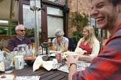 Family enjoying a meal together, Warwickshire - John Harris - 2010s,2016,enjoying,ENJOYMENT,families,Family,FEMALE,HUMOUR,laugh,laughing,laughter,Leisure,LFL,LIFE,Lifestyle,male,man,men,people,person,persons,RECREATION,RECREATIONAL,Saturday,Sunday,Warwickshire,W