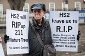 Local residents protest at loss of over 200 mature trees, a burial ground and park around Euston station to make way for HS2 construction work, London - Philip Wolmuth - 2010s,2018,activist,activists,against,age,ageing population,BUILDING,burial,CAMPAIGN,campaigner,campaigners,CAMPAIGNING,CAMPAIGNS,cities,City,construction,DEMONSTRATING,demonstration,DEMONSTRATIONS,de
