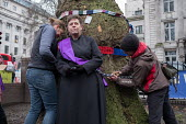 Vicar chained to tree in HS2 Euston protest. Rev Anne Stevens, Vicar of St Pancras, chained to one of more than 200 mature trees before felling begins to make way for HS2 construction trucks at Euston... - Philip Wolmuth - 2010s,2018,activist,activists,against,anglican,anglicanism,anglicans,Belief,BUILDING,CAMPAIGN,campaigner,campaigners,CAMPAIGNING,CAMPAIGNS,chained,cities,City,construction,conviction,DEMONSTRATING,dem