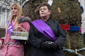 Vicar chained to tree in HS2 Euston protest. Local resident Jo Hurtfurd and Revd Anne Stevens, Vicar of St Pancras, chained to one of more than 200 mature trees before felling begins to make way for H... - Philip Wolmuth - 2010s,2018,activist,activists,against,anglican,anglicanism,anglicans,Belief,BUILDING,CAMPAIGN,campaigner,campaigners,CAMPAIGNING,CAMPAIGNS,chained,cities,City,construction,conviction,DEMONSTRATING,dem