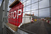 Carillion liquidation, thousands of jobs at risk. Work has stopped the 350 million Midland Metropolitan Hospital, Smethwick, Birmingham. Closed and padlocked gates - John Harris - 2010s,2018,administration,bankrupt,bankruptcy,Brownfield Site,building site,Carillion,cities,City,close,closed,closing,closure,closures,communicating,communication,Construction Industry,EBF,Economic,E