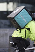 Deliveroo delivery worker, Birmingham - John Harris - 2010s,2018,app,application,applications,apps,backpack,bicycle,bicycles,BICYCLING,Bicyclist,Bicyclists,BIKE,BIKES,Birmingham,by hand,carries,carry,carrying,cities,city,collecting,contracts,Courier,Cour