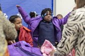 Detroit, Michigan, USA Hyundai Motor America Annual Coats for Kids program distributing 1,000 winter coats to school children, Carstens Elementary Middle School, in conjunction with Carstens Acadamy a... - Jim West - 2010s,2018,adult,adults,African American,African Americans,America,american,americans,anorak,anoraks,apparel,auto,automotive,Automotive Industry,BAME,BAMEs,black,BME,bmes,Car Industry,carindustry,Cars