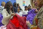 Detroit, Michigan, USA Hyundai Motor America Annual Coats for Kids program distributing 1,000 winter coats to school children, Carstens Elementary Middle School, in conjunction with Carstens Acadamy a... - Jim West - 17-01-2018