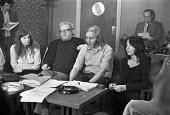 William Tyndale School, North London 1975 Terry Ellis headteacher (C) and Brian Haddow (deputy, with glasses), with other teachers, giving a press conference to defend their radical child centred syst... - NLA - 1970s,1975,activist,activists,Brian Haddow,CAMPAIGNING,CAMPAIGNS,conference,conferences,DEMONSTRATING,Demonstration,dismissal,EDU,educate,educating,Education,educational,FEMALE,giving,government,HEAD