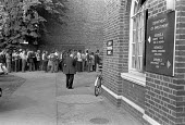 Unemployed queuing, Brixton Labour Exchange, South London 1975 - NLA - 1970s,1975,agency,benefit office,dole queue,employee,employees,Employment,Exchange,job,Job centre,Jobcentre Plus,jobless,jobs,jobseeker,jobseekers,LBR,London,male,man,Marginalised,men,people,person,pe