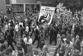 National Front march with a counter demonstration alongside, London 1975 Racist Stop the Muggers banner, Martin Webster (C) - NLA - 06-09-1975
