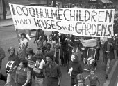 1,000 children living in council tower blocks protest for houses with gardens, Hulme, Manchester 1975 - NLA - 1970s,1975,activist,activists,adolescence,adolescent,adolescents,banner,banners,boy,boys,CAMPAIGNING,CAMPAIGNS,child,CHILDHOOD,children,council,council housing,council housing,DEMONSTRATING,Demonstrat