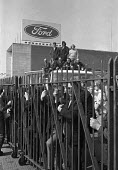 Ford workers occupy the Swansea factory in a pay dispute, Wales 1975 - Martin Mayer - 1970s,1975,AUEW,auto,automotive,Automotive Industry,capitalism,capitalist,Car Industry,car worker,car workers,carindustry,dispute,disputes,EARNINGS,FACTORIES,factory,Ford,gate,gates,Income,INCOMES,Ind