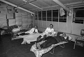 Workers occupy Plessey factory, Swindon 1974 in a pay dispute. Sleeping arrangements - Martin Mayer - 11-12-1974