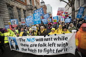 NHS in Crisis - Fix it now protest organised by the Peoples Assembly and Health Campaigns Together, Central London. Banner has a quote from Aneurin Bevan, who inaugurated the NHS in 1948, that The NHS... - Jess Hurd - 2010s,2018,activist,activists,Austerity Cuts,banner,banners,CAMPAIGNING,CAMPAIGNS,Crisis,DEMONSTRATING,demonstration,Ernest Bevin,FEMALE,Health Campaigns Together,HEALTH SERVICES,healthcare,London,mal