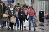 Teenage girls shopping, Gloucester city centre - John Harris - 2010s,2018,adolescence,adolescent,adolescents,apparel,bag,bags,bought,buying,cities,City,clothes,clothing,commodities,commodity,communicating,communication,consumer,consumers,conversation,conversation