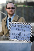 Domestic Extremist Day protest against state spying and disruption of political organisations outside New Scotland Yard, Embankment, London - Jess Hurd - 2010s,2018,activist,activists,against,CAMPAIGNING,CAMPAIGNS,civil rights,database,DEMONSTRATING,demonstration,Domestic,Domestic Extremist,Domestic Extremist Day,Embankment,London,New Scotland Yard,out