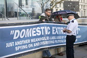 Domestic Extremist Day protest campaigning against state spying and disruption of political organisatoins outside New Scotland Yard, Embankment, London. - Jess Hurd - 2010s,2018,activist,activists,against,banner,banners,CAMPAIGN,campaigning,CAMPAIGNS,civil rights,database,DEMONSTRATING,demonstration,Domestic,Domestic Extremist,Domestic Extremist Day,Embankment,Lond