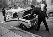 Police searching cars near Lambeth Magistrates Court, London 1973 during the trial of the Belfast 10 on charges made after the London bomb explosions on March 8 - Peter Arkell - 1970s,1973,adult,adults,AUTO,AUTOMOBILE,AUTOMOBILES,AUTOMOTIVE,Belfast 10,bomb,bombs,bonnet,car,cars,check,checking,CLJ,conflict,court,court case,courts,device,devices,explosive,explosives,force,IRA,L