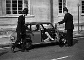 Police searching cars near Lambeth Magistrates Court, London 1973 during the trial of the Belfast 10 on charges made after the London bomb explosions on March 8. - Peter Arkell - 1970s,1973,adult,adults,AUTO,AUTOMOBILE,AUTOMOBILES,AUTOMOTIVE,Belfast 10,bomb,bombs,car,cars,check,checking,CLJ,conflict,court,court case,courts,device,devices,explosive,explosives,FEMALE,force,IRA,L