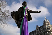 David Lloyd George statue draped in the Suffragette flag to celebrate the centenary of womens suffrage, Parliament Square, London - Jess Hurd - 06-02-2018