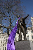 David Lloyd George statue draped in the Suffragette flag to celebrate the centenary of womens suffrage, Parliament Square, London - Jess Hurd - 2010s,2018,ACE,activist,activists,Arts,CAMPAIGNING,CAMPAIGNS,celebrate,CELEBRATING,centenary,cities,City,Commemorate The Centenary Of Women's Suffrage,Culture,David Lloyd George,DEMONSTRATING,demonstr