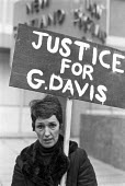 Goerge Davis is Innocent campaign 1975. Rose Davis, his wife, at a vigil outside New Scotland Yard to highlight the miscarriage of justice when her husband was jailed for an armed robbery he did not c... - NLA - 1970s,1975,activist,activists,armed,campaign,campaigning,CAMPAIGNS,cities,City,DEMONSTRATING,Demonstration,FEMALE,George Davis,Goerge Davis is Innocent,Goerge Davis is Innocent OK,husband,justice,misc