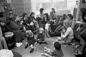Home for battered wives, Chiswick, West London, 1975, Erin Pizzey talking (L) to residents - NLA - 1970s,1975,abuse,accommodation,adult,adults,against,BAME,BAMEs,Battered wives,Black,Black and White,BME,bmes,boy,boys,child,CHILDHOOD,children,Chiswick Womens Aid,cities,City,communicating,communicati