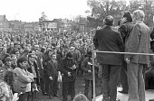 Mass meeting of Chrysler workers, Stoke Green, Coventry 1975 facing redundancies to save the factory as Crysler make a loss - NLA - 1970s,1975,against,AUEW,Chrysler,cities,City,Coventry,Duncan Simpson,FACTORIES,factory,job loss,Job Losses,jobs,loss,losses,Mass,Mass Meeting,mass meetings,meeting,MEETINGS,member,member members,membe