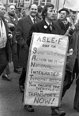 ASLEF workers protest against proposed cuts, London 1975 For an Intergrated Transport System - NLA - 1970s,1975,activist,activists,against,ASLEF,CAMPAIGNING,CAMPAIGNS,cities,City,cuts,DEMONSTRATING,Demonstration,London,male,man,member,member members,members,men,people,person,persons,placard,placards,