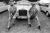 Top hats and Rolls Royce, wealthy at Royal Ascot 1982 - Katalin Arkell - 1980s,1982,AFFLUENCE,AFFLUENT,Ascot,AUTO,AUTOMOBILE,AUTOMOBILES,AUTOMOTIVE,Bourgeoisie,car,car park,cars,Domesticated Ungulates,elite,elitism,equestrian,equine,hat,hats,high,high income,horse,horse ra