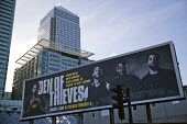 Den of Thieves, American heist film advertisement, Canary Wharf, Bank of America, London Docklands - Jess Hurd - 2010s,2018,advertisement,advertisements,advertising,America,American,americans,Bank,Bank of America,Banks,billboard,billboards,blocks,business,Canary Wharf,capitalism,capitalist,Christian Gudegast,cit