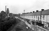 Coal dug from Easington Colliery in railway sidings next to terraced miners cottages 1948 - Elisabeth Chat - 01-06-1948
