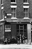 Men waiting for the pub to open, Vauxhall, Liverpool 1975 - John Sturrock - 1970s,1975,alcohol,cities,City,close,closed,closing,closure,closures,desolate,drink,drinker,drinkers,drinking,EBF,Economic,Economy,excluded,exclusion,HARDSHIP,impoverished,impoverishment,INEQUALITY,in
