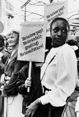 ETA/ABS secretarial and clerical staff trades union national rally, 1984 for better pay and conditions for support staff - Stefano Cagnoni - 1980s,1984,ABS,activist,activists,BAME,BAMEs,banner banners,BETA,black,BME,bmes,CAMPAIGN,campaigner,campaigners,CAMPAIGNING,CAMPAIGNS,cities,City,clerical,clerk,clerks,DEMONSTRATING,Demonstration,DEMO