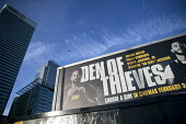 Den of Thieves, American heist film advertisement with HSBC, Canary Wharf, London Docklands - Jess Hurd - 2010s,2018,advertisement,advertisements,advertising,America,American,americans,Bank,Bank of America,Banks,billboard,billboards,blocks,business,Canary Wharf,capitalism,capitalist,Christian Gudegast,cit